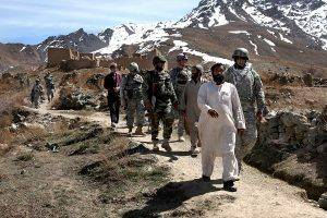 An Afghan leads U.S. Army soldiers from the Ground Combat Platoon, Echo company, 4-3 Aviation Battalion and Afghan National Army  soldiers through the village of Akbar Kheyl, Pole-Elam district, Logar province, Afghanistan, March 18. The U.S. Army and A.N.A. are conducting a Key Leader Engagement with the village elders in order to check on conditions in the village.