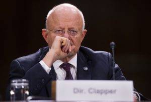 "UNITED STATES - APRIL 18: James Clapper, Director of National Intelligence, prepares to testify at a Senate Armed Services Committee hearing in Dirksen Building titled ""Current and Future Worldwide Threats,"" featuring testimony by he and Army Lt. Gen. Michael Flynn, director of the Defense Intelligence Agency. (Photo By Tom Williams/CQ Roll Call)"