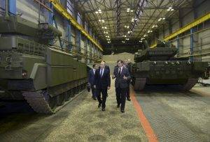 Russian President Vladimir Putin and head of Ural Transport Machine Building Design Bureau Terlikov visit Uralvagonzavod factory in Nizhny Tagil