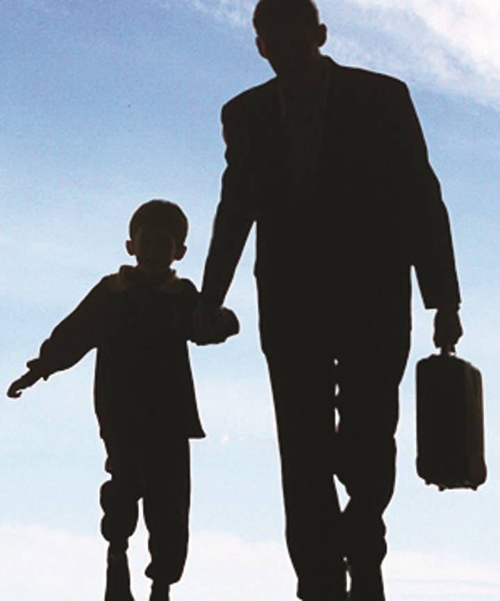 A father leads his son, 17 August 2004. THE AGE NEWS Picture by SIMON SCHLUTER.
